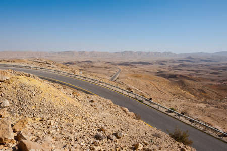 Asphalt Road above Grand Crater in Negev Desert, Israel photo