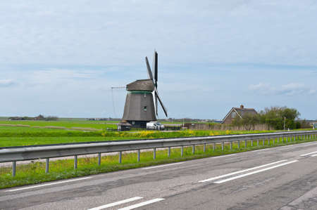 Old Dutch Windmill at the Modern Highway photo