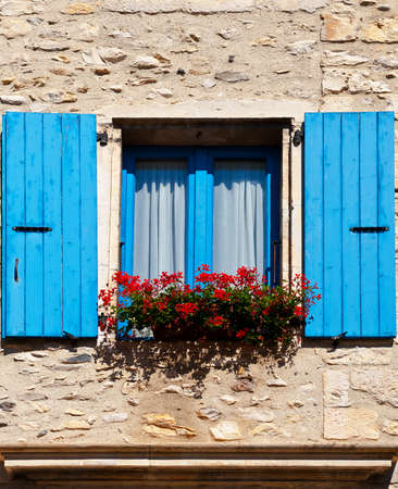Window with Open Wooden Shutters, Decorated With Fresh Flowers photo