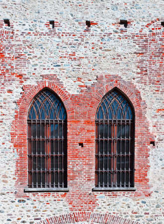 Closed  Gothic Windows on Old Brick Wall photo