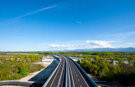 snowcapped: The Modern Highway in Piedmont on the Background of Snow-capped Alps, Italy