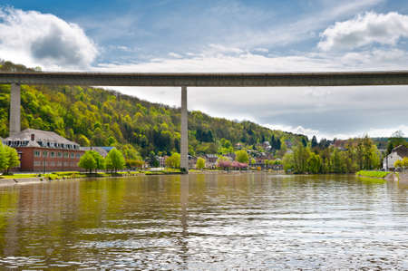 Concrete Bridge and Embankment of the River Meuse in the Belgian City of Dinant photo