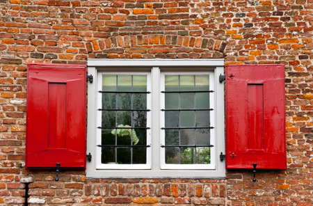 Window with Red Shutters in the Dutch City photo