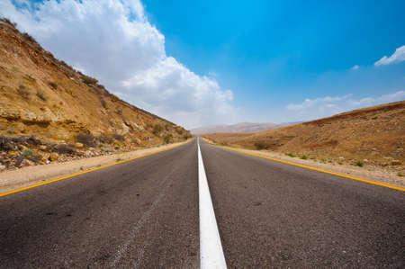 Asphalt Road in Sand Hills of Samaria, Israel Stock Photo - 15032515