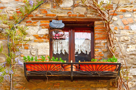Closed Italian Window  Decorated With Fresh Flowers photo