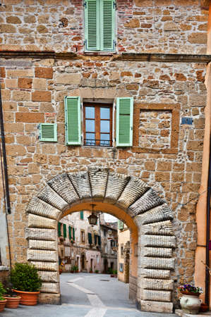 Narrow Alley with Old Buildings in the Italian City of Sorano photo
