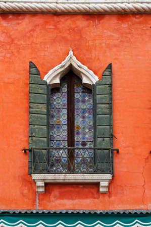 resplendence: Venetian Window on the Facade of the Restored Italian Home Stock Photo
