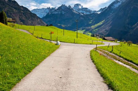 Milk Cans at the Crossroads High Up in the Swiss Alps Stock Photo - 15607293