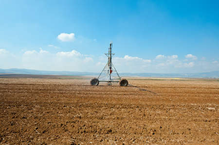 Sprinkler Irrigation on a plowed Field in Israel Stock Photo - 15933981