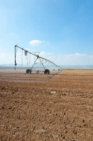 israel agriculture: Sprinkler Irrigation on a plowed Field in Israel Stock Photo