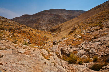 Harsh Mountainous Terrain in the West Bank, Israel photo