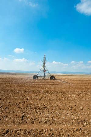 Sprinkler Irrigation on a Plowed Field in Israel Stock Photo - 16401624