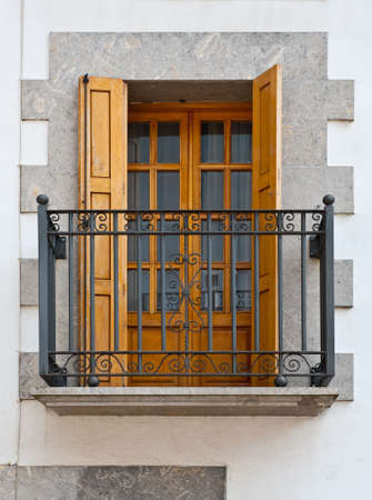 resplendence: The Renovated Facade of the Old Spanish House with Balcony Stock Photo