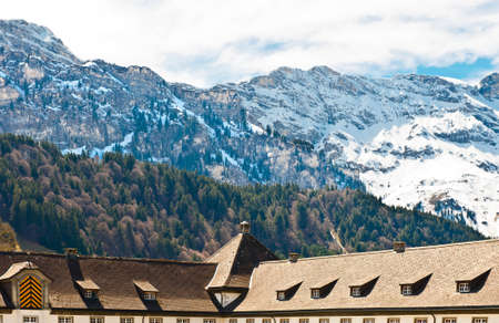 Mansard on the Background of Snow-capped Alps, Switzerland Stock Photo - 16729592