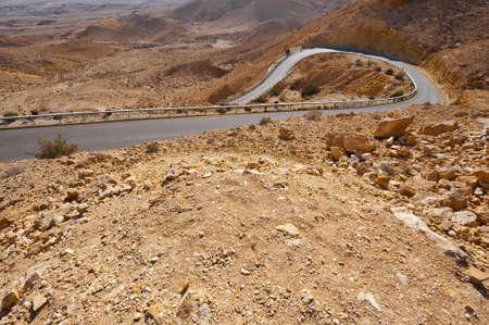 Asphalt Road in Grand Crater in Negev Desert, Israel photo