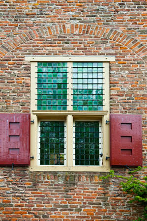 city house with window bike in front of a brick facade of the old dutch house stock photo