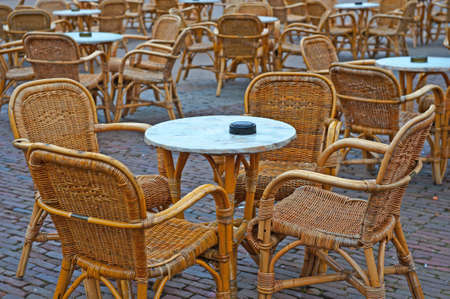 Wicker Chairs and Tables in a Street Cafe photo