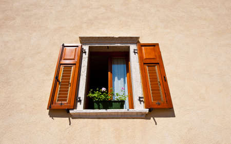 Window on the Facade of the Restored Italian Home photo