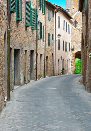 Narrow Alley with Old Buildings in the Italian City  photo
