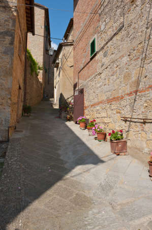 Narrow Alley with Old Buildings in Tuscany photo