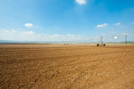 Sprinkler Irrigation on a Plowed Field in Israel Stock Photo - 16990592