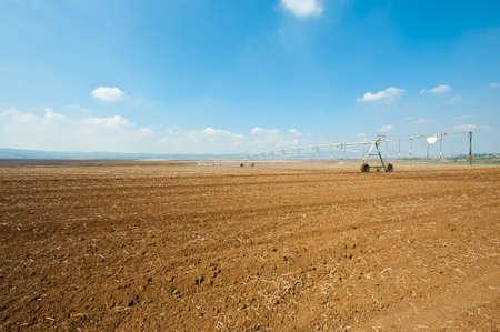 Sprinkler Irrigation on a Plowed Field in Israel Stock Photo - 16990592