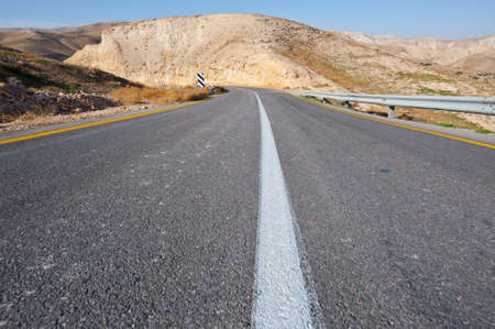 Meandering Road in Sand Hills of Judean Mountains, Israel photo