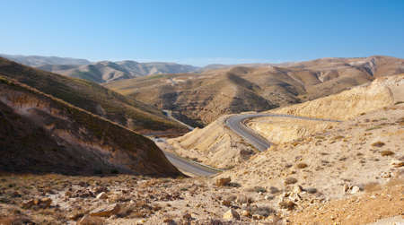 judean hills: Meandering Road in Sand Hills of Judean Mountain, Israel Stock Photo