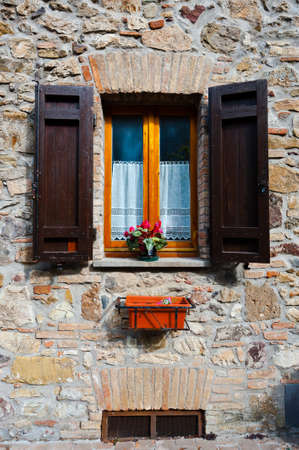 Italian Window with Open Wooden Shutters photo