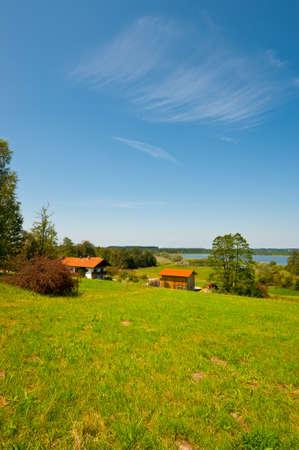 Farmhouse on the shore of Bavarian Lake Simssee, Germany photo