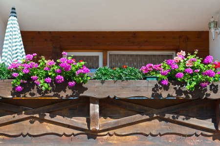 Wooden Loft Decorated With Fresh Flowers in the Bavarian Alps, Germany photo