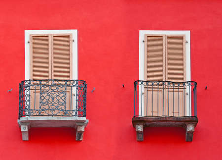 The Renovated Facade of the Old Italian House with Balconies Stock Photo - 18410894