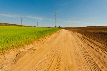 furrow: High-voltage Power Line Passes through the Plowed Fields in Israel