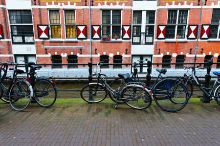 Bikes at the Embankment of Canal in Amsterdam
