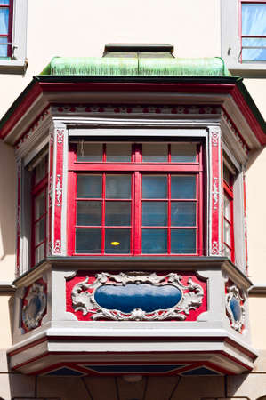 The Renovated Facade of the Old Swiss House with Balcony Stock Photo - 20885851