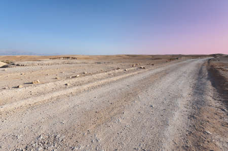vadi: Dirt Road in the Judean Desert on the West Bank, Sunset  Stock Photo