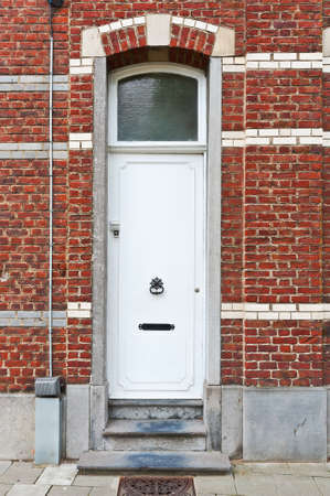 lacquered: White Lacquered Door in the Belgian City