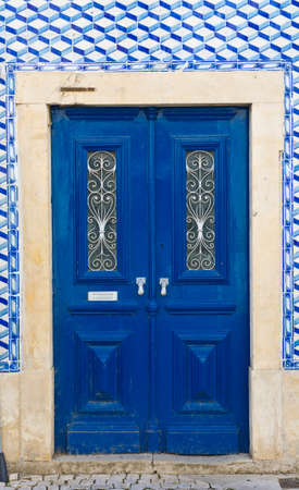 resplendence: Wooden Door in the Wall Decorated with Portuguese Ceramic Tiles
