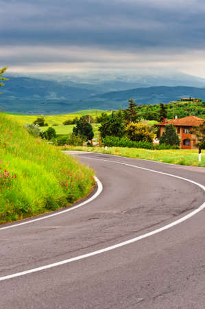 Asphalt Road Leading to the Farmhouse in Umbria, Italy photo