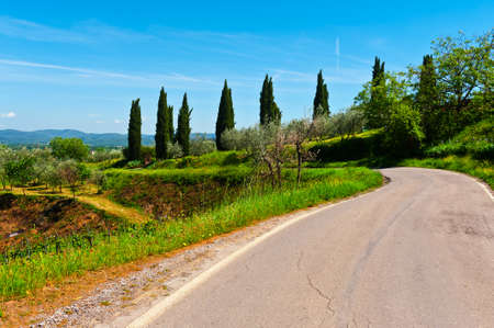 apennines: Asphalt Road Leading to the Farmhouse in Umbria, Italy