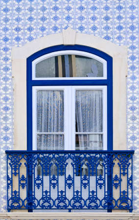 castings: Window Decorated with Portuguese Ceramic Tiles  Stock Photo