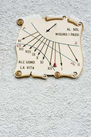 Sundial on the Wall of Italian Building photo