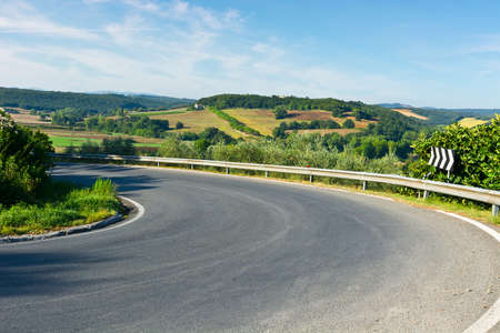 lacet: Winding Paved Road in the Tuscany, Italy