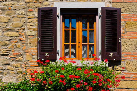 Italian Window with Open Wooden Shutters, Decorated With Fresh Flowers photo