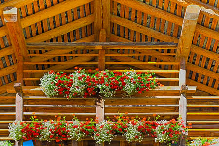 Wooden Loft Decorated With Fresh Flowers in the Italian Alps photo