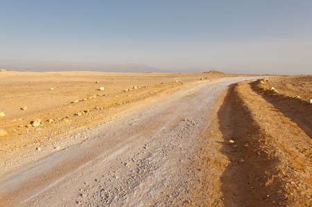 Dirt Road in Desert on the West Bank of the Jordan River photo