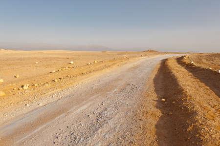 vadi: Dirt Road in Desert on the West Bank of the Jordan River