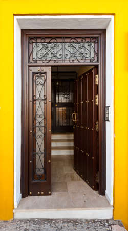Wooden Open Door in Spanish City photo