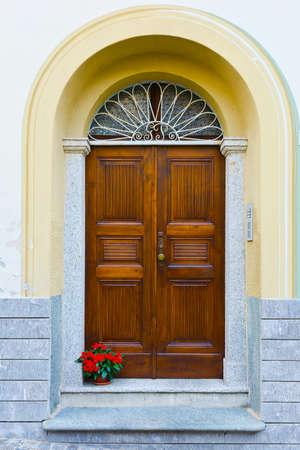 renewed: Wooden Ancient Italian Door in Historic Center Stock Photo