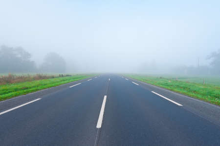 Asphalt Road in the Morning Mist photo
